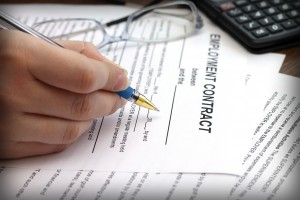 picture of woman signing employment agreement